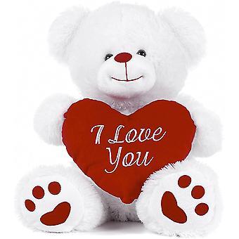 Hvit bamse holder rødt hjerte med jeg elsker deg skrevet på den