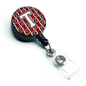 Litera T piłki nożnej kardynał i biały znaczek chowany bębnowa