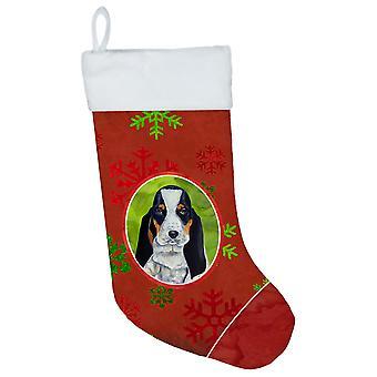 كلب الصيد الباسط الثلج الأحمر والأخضر عطلة عيد الميلاد عيد الميلاد تخزين