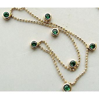 14 carat gold necklace with emerald