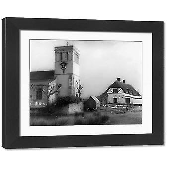 England/Haddenham. Framed Photo. The old church and thatched cottages at Haddenham,.
