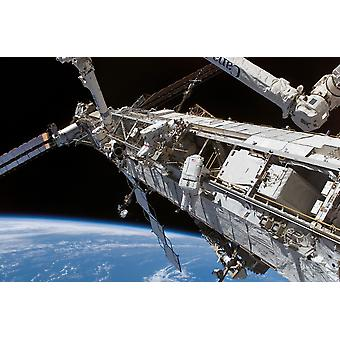 Astronauts participate in extravehicular activity Poster Print