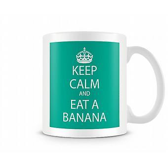 Kalmte bewaren en eten van een banaan bedrukte mok