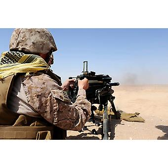 Soldier fires the Mk 19 grenade launcher Poster Print by Stocktrek Images