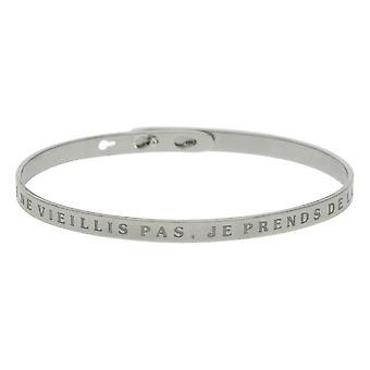 'JE NE VIEILLIS PAS, JE PRENDS DE LA VALEUR' bracelet jonc argenté à message