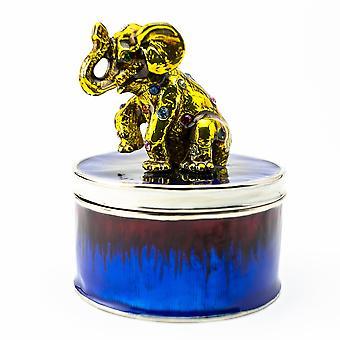 Éléphant d'or sur la boîte bleue de bibelot