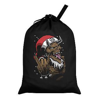 Grindstore Satan legt schwarzen Weihnachtsmann