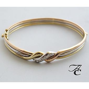Bracciale in oro tricolore con diamante