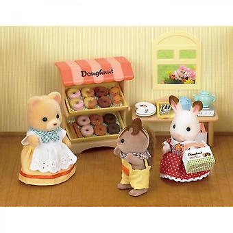 Las familias de Sylvanian están paradas los donuts y el juego de la figurilla