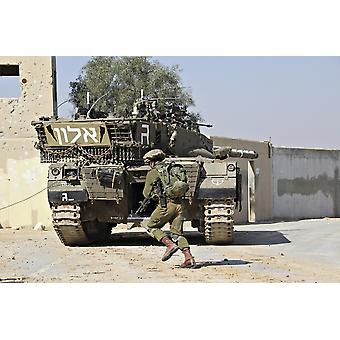 An Israel Defense Force Merkava Mark II main battle tank demonstrates urban warfare techniques Poster Print