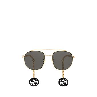 Gucci GG0727S kultainen unisex aurinkolasit