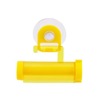Suction cup toothpaste squeezer