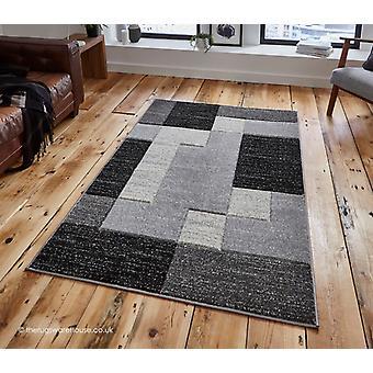 Puslespil grå sort tæppe