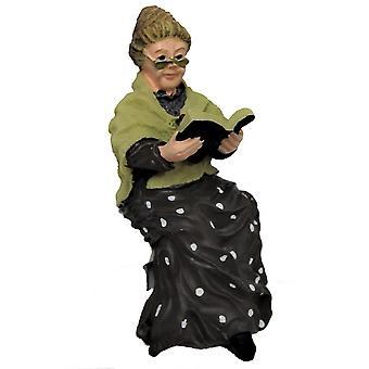 Nukketalo Vanha nainen istuu kirjan kanssa 1:12 Ihmiset näätähahmo