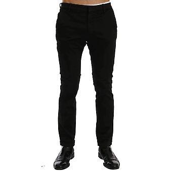 Calças pretas de algodão slim fit