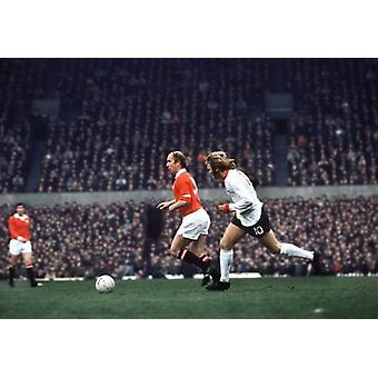 Bobby Charlton on the ball during his last home game for Manchester United. Large Framed Photo..