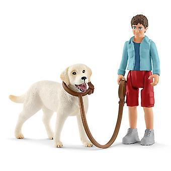 Schleich marchant avec le retriever de labrador