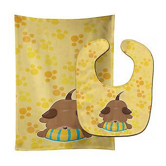 Carolines trésors BB7076STBU chiot sur jaune Pawprints Baby Bib & tissu