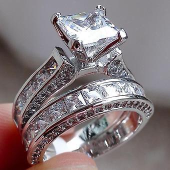 Clásico hermoso anillo doble con piedra grande en zircón