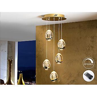 Schuller Roc - LED-lampa på 5 lampor. Tillverkad av metall, gyllene finish. Glas nyanser med släpp form gjord av massivt glas, i champagne tonalitet, med dekorativa bubblor inuti. Justerbara i längd. 25W LED. 2.400 lm. 3.000 K. DIMMABLE. Fjärrkontroll ingår. - 783529D