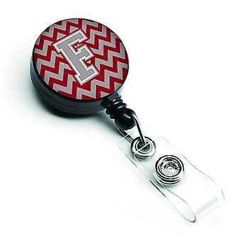 Kołowrotek chowany odznaka Crimson Chevron litery F i szary