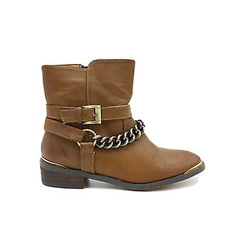 Boots with women's gold chains