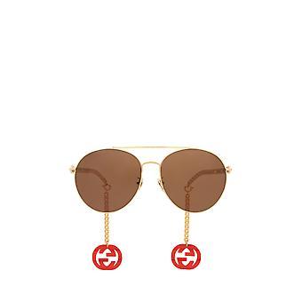 Gucci GG0725S gold female sunglasses