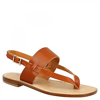 Leonardo Shoes Women's handmade flat thong sandals in tan calf leather with buckle closure