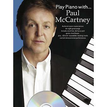 とピアノを弾く.ポールマッカートニー