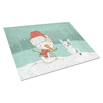 Musta ja valkoinen terrieri lumi ukko joulua lasin leikkuu lauta suuri